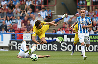 Referee Chris Kavanagh awards a penalty for this challenge on Chelsea's Marcos Alonso by Huddersfield Town's Christopher Schindler <br /> <br /> Photographer Stephen White/CameraSport<br /> <br /> The Premier League - Huddersfield Town v Chelsea - Saturday August 11th 2018 - The John Smith&rsquo;s Stadium<br />  - Huddersfield<br /> <br /> World Copyright &copy; 2018 CameraSport. All rights reserved. 43 Linden Ave. Countesthorpe. Leicester. England. LE8 5PG - Tel: +44 (0) 116 277 4147 - admin@camerasport.com - www.camerasport.com