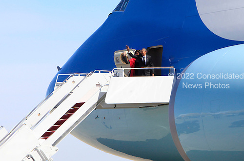 United States President Barack Obama and First Lady Michelle Obama board Air Force One at Joint Base Andrews in Maryland en route to Maxwell Air Force Base in Alabama where they will participate in a commemoration of the 50th anniversary of the march in Selma, Alabama on March 7, 2015. The motorcade traveled to Joint Base Andrews due to a lockdown at the White House. <br /> Credit: Dennis Brack / Pool via CNP