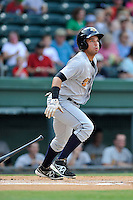 Second baseman Vicente Conde (4) of the Charleston RiverDogs bats in a game against the Greenville Drive on Sunday, August 16, 2015, at Fluor Field at the West End in Greenville, South Carolina. Charleston won, 6-2. (Tom Priddy/Four Seam Images)