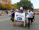 WATERBURY, CT - 08 OCTOBER 2017 -101417JW05.jpg -- The Thomaston Savings Bank team uses a super soaker to try to deter the competition during the 2017 United Way Bed Race Fundraiser Saturday morning. Jonathan Wilcox Republican-American