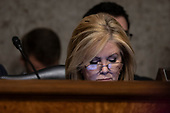 Senator Marsha Blackburn, Republican of Tennessee, looks at her phone during a Senate Commerce Committee hearing on Capitol Hill in Washington, DC on February 6, 2019. Credit: Alex Edelman / CNP