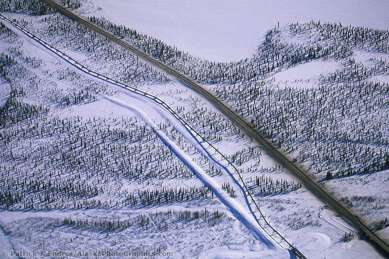 Trans Alaska oil pipeline and the James Dalton highway in Alaska's winter Arctic.