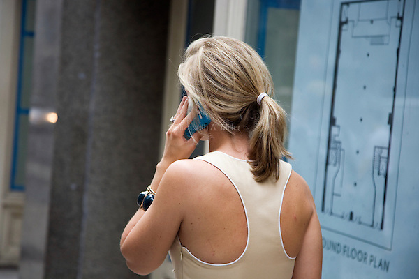 "A woman walks down 18th Street in New York City, talking on her cell phone on June 1st, 2011.  The World Health Organization (WHO) has listed mobile phone use in the same ""carcinogenic hazard"" category as lead, engine exhaust, and chloroform, making use of cell phones a possible cancer risk."