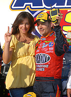 Apr 29, 2007; Talladega, AL, USA; Nascar Nextel Cup Series driver Jeff Gordon (24) celebrates with his pregnant wife Ingrid Vandebosch after winning the Aarons 499 at Talladega Superspeedway. Mandatory Credit: Mark J. Rebilas