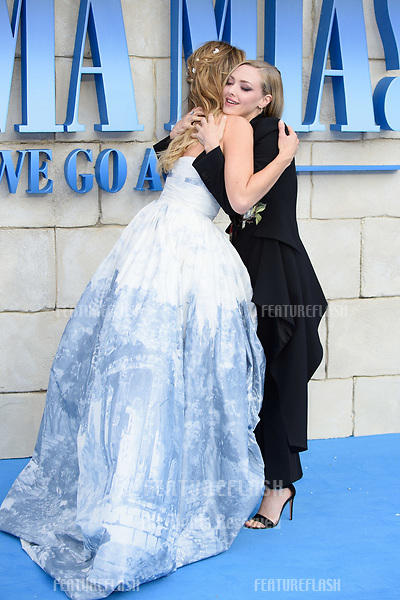 """Lily James & Amanda Seyfried arriving for the """"Mama Mia! Here We Go Again"""" world premiere at the Eventim Apollo, Hammersmith, London, UK. <br /> 16 July  2018<br /> Picture: Steve Vas/Featureflash/SilverHub 0208 004 5359 sales@silverhubmedia.com"""