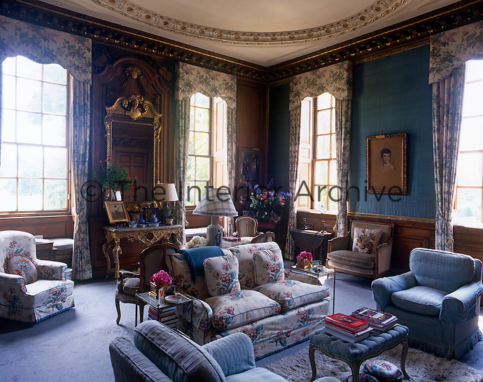 This elegant wood-panelled drawing room is furnished in a comfortable English country style