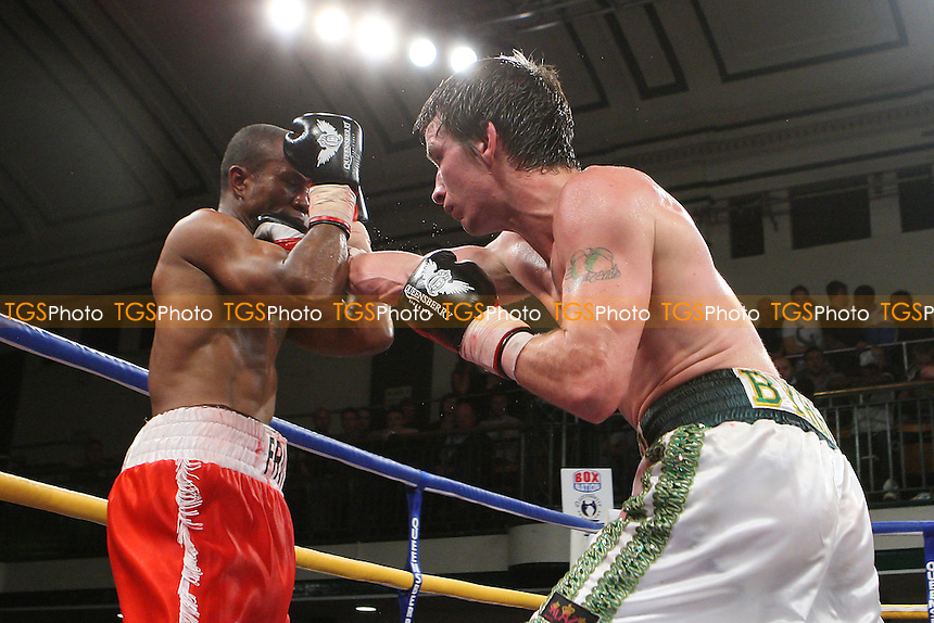 Dean Byrne (white shorts) defeats Michael Frontin in a Welterweight boxing contest at York Hall, Bethnal Green, promoted by Frank Warren - 21/10/11 - MANDATORY CREDIT: Gavin Ellis/TGSPHOTO - Self billing applies where appropriate - 0845 094 6026 - contact@tgsphoto.co.uk - NO UNPAID USE