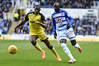 Modou Barrow of Reading is challenged by Lucas Akins of Burton Albion during the Sky Bet Championship match between Reading and Burton Albion at the Madejski Stadium, Reading, England on 23 December 2017. Photo by Paul Paxford.