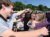 NWA Democrat-Gazette/ANDY SHUPE<br /> Students take part Friday, May 5, 2017, in the ninth annual Moving Up ceremony at Harmon Stadium at the school. After recognitions for group and team achievements, seniors are given the opportunity to speak to their teachers as they leave the school for the final time. Members of the freshman, sophomore and junior classes then move up ceremoniously to the next grade level.