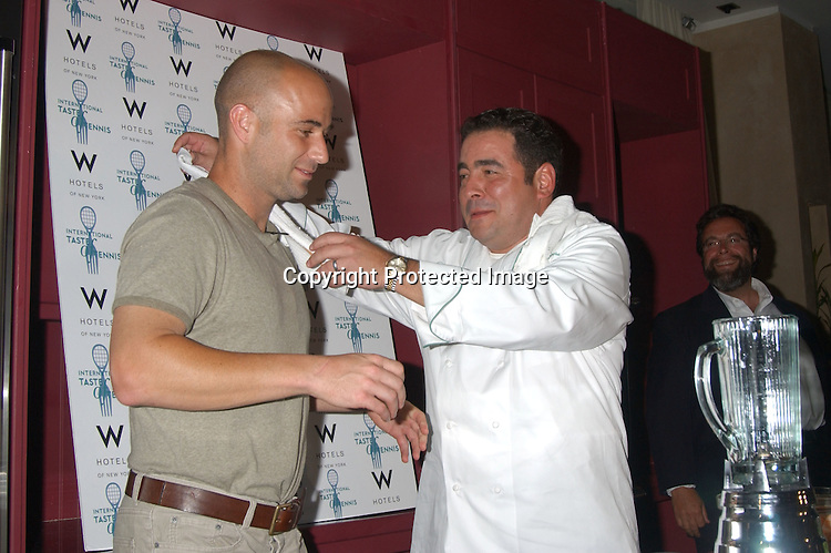 ..Andre Agassi and Chef Emeril Lagasse ..at the 4th Annual International Taste of Tennis Fundraiser ..for City Meals on Wheels on August 21,2003 at the W Hotel in New York City, New York...Photo by Robin Platzer, Twin Images