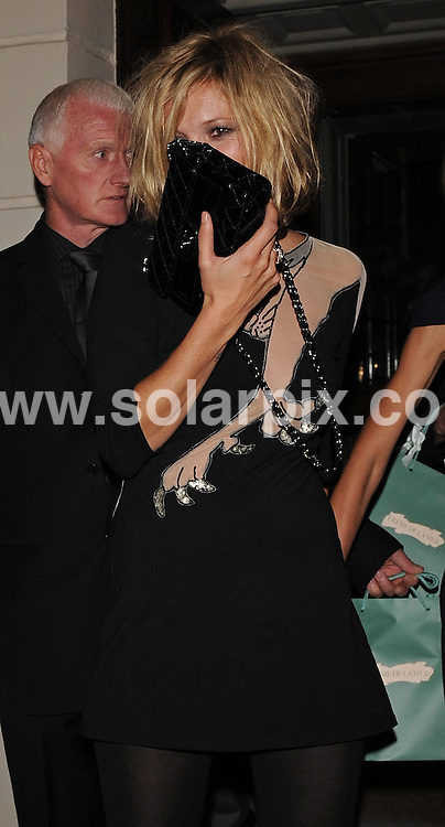 **ALL ROUND PICTURES FROM SOLARPIX.COM**.**WORLDWIDE SYNDICATION RIGHTS**.Kate Moss and Allegra Versace depart from the Vogue Magazine dinner Browns Hotel before going on to the Vivienne Westwood afterparty at 333 Portland Place, London.  Friday September 19, 2008..This pic: Kate Moss..JOB REF: 7401 SSD     DATE: 18_09_2008.**MUST CREDIT SOLARPIX.COM OR DOUBLE FEE WILL BE CHARGED* *UNDER NO CIRCUMSTANCES IS THIS IMAGE TO BE REPRODUCED FOR ANY ONLINE EDITION WITHOUT PRIOR PERMISSION*