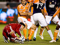 Houston Dynamo goalkeeper Pat Onstad (18) makes a save in a dicy situation. The Houston Dynamo defeated CD Chivas USA 2-0 at Home Depot Center stadium in Carson, California on Saturday May 8, 2010.  .