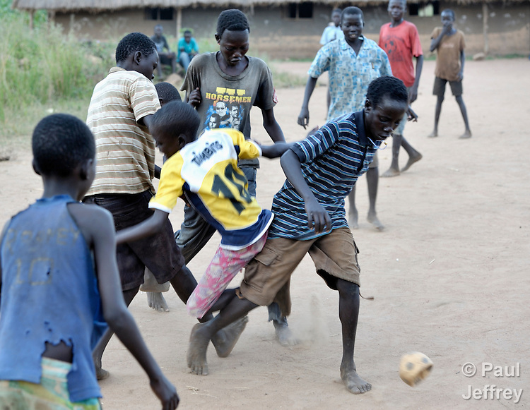 Children play football/soccer in Pisak, a village in Southern Sudan's Central Equatoria State. NOTE: In July 2011 Southern Sudan became the independent country of South Sudan.