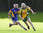 X of Newmarket in action against Teresa O Keeffe of Inagh-Kilnamona during their senior county final in Clarecastle. Photograph by John Kelly.