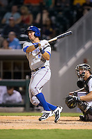J.P. Arencibia (16) of the Durham Bulls follows through on his swing against the Charlotte Knights at BB&T BallPark on July 22, 2015 in Charlotte, North Carolina.  The Knights defeated the Bulls 6-4.  (Brian Westerholt/Four Seam Images)