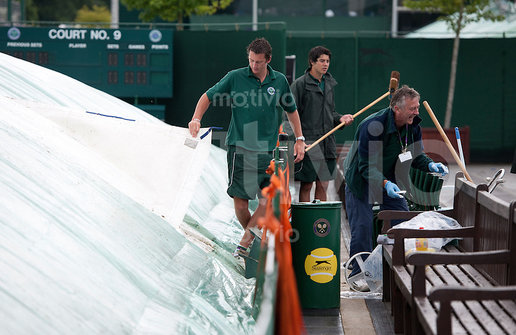 Ground staff work on a covered court. The Wimbledon Championships 2010 The All England Lawn Tennis & Croquet Club  Day 8 Tuedsday 29/06/2010