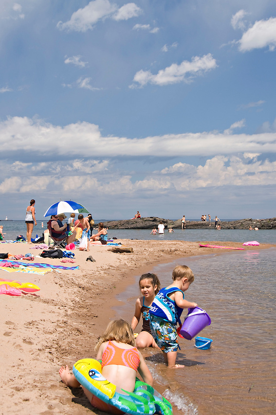 A family at the McCarty Cove beach on Lake Superior in Marquette Michigan.