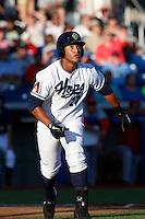 Cesar Carrasco #27 of the Hillsboro Hops runs to first base during a game against the Spokane Indians at Hillsboro Ballpark on July 22, 2013 in Hillsboro Oregon. Spokane defeated Hillsboro, 11-3. (Larry Goren/Four Seam Images)