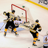 Boston Bruins left wing Brad Marchand #63 shoots the puck past Buffalo Sabres goalie Jhonas Enroth #1 during third period action at TD Garden. Marchand's score brought the score to Bruins 6 Sabres 1...GATEHOUSE NEWS SERVICE PHOTO BY ERIC CANHA