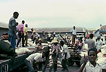 Unloading flour from a flat based truck.  Images of the capital,Port au Prince, Haiti 1975