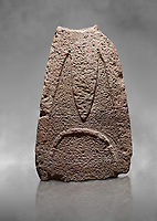 Late European Neolithic prehistoric Menhir standing stone with carvings on its face side. The representation of a stylalised male figure starts at the top with a long nose from which 2 eyebrows arch around the top of the stone. Excavated from Paule Luturru,  Samugheo. Menhir Museum, Museo della Statuaria Prehistorica in Sardegna, Museum of Prehoistoric Sardinian Statues, Palazzo Aymerich, Laconi, Sardinia, Italy