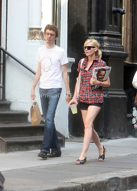 """WWW.ACEPIXS.COM ** ** ** ....July 8 2008, New York City....""""Spiderman"""" actress Kirsten Dunst was out walking with a friend in Soho, whilst carryinmg a copy of 'Rolling Stone' Magazine on July 8 2008 in New York City........Please byline: STAN ROSE -- ACEPIXS.COM.. *** ***  ..Ace Pictures, Inc:  ..tel: (646) 769 0430..e-mail: info@acepixs.com..web: http://www.acepixs.com"""