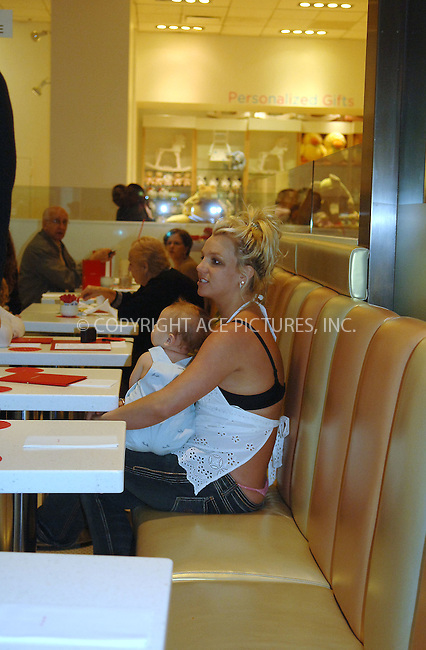 WWW.ACEPIXS.COM....May 18 2006, New York City....Singer Britney Spears took her baby son Sean Preston from their hotel to toy shop  F A O Schwartz in midtown Manhattan. Britney, who is pregnant with her second child, was wearing an unusual top which allowed her black bra to be on view from the back, and her pink thong was also visible. Spears took a seat near the window of the store and eventually began to cry.....Please byline: BRETT KAFFEE/ACEPIXS.COM....For information please contact Philip Vaughan:..tel: 212 243 8787 or 646 769 0430..e-mail: info@acepixs.com..website: www.acepixs.com