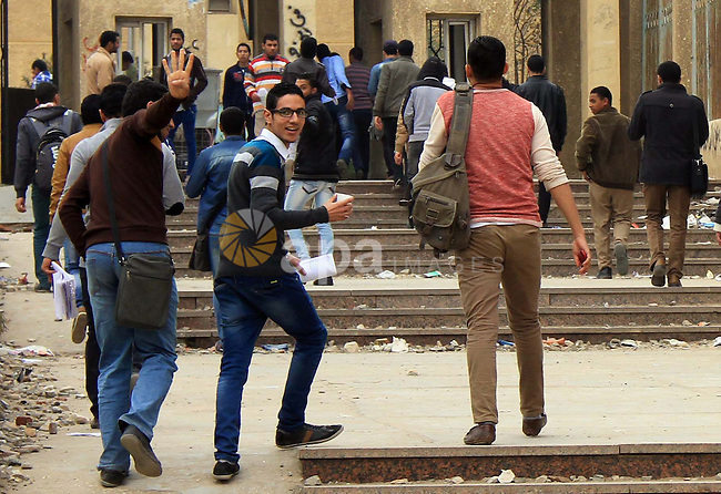 Egyptian students return to study at the Al-Azhar University in Cairo on January 4, 2014. On January 3, 2014, at least 13 people died in clashes across Egypt as police dispersed thousands of protesters demanding the reinstatement of deposed Islamist president Mohamed Morsi, the health ministry said. Photo by Mohammed Bendari