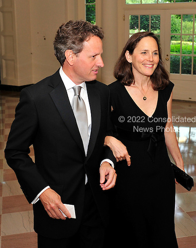 United States Secretary of the Treasury Timothy Geithner, and his wife, Carole, arrive for a State Dinner in honor of Chancellor Angela Merkel of Germany at the White House in Washington, D.C.  on Tuesday, June 7, 2011.Credit: Ron Sachs / CNP