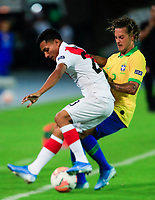 ARMENIA, COLOMBIA - JANUARY 19: Peru's Kevin Sandoval fights for the ball against Brazil's Guga during their CONMEBOL Pre-Olympic soccer game at Centenario Stadium on January 19, 2020 in Armenia, Colombia. (Photo by Daniel Munoz/VIEW press/Getty Images)
