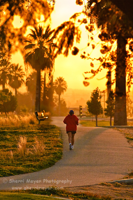Woman running at Panorama Park during sunset, Bakersfield, California.