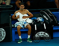 2nd February 2020; Melbourne Park, Melbourne, Victoria, Australia; Australian Open Tennis, Mens singles final on Day 14; Novak Djokovic of Serbia changes his shirt during his singles final match against Dominic Thiem of Austria