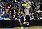 Plymouth's Adrian Moore celebrates hitting a 3-pointer late in the first half of Winston-Salem Prep's 61-49 win in the State Championship at the Dean Smith Center in Chapel Hill, NC, on Saturday, March 10, 2012.  Photo by Ted Richardson