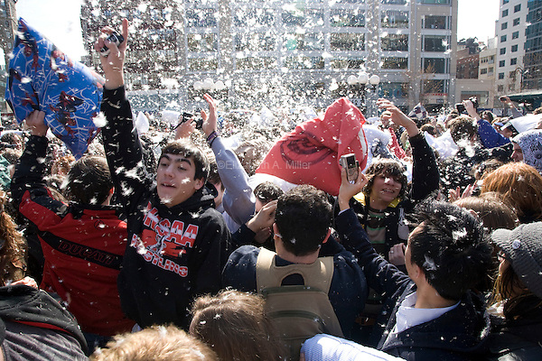 A massive pillow fight takes place in Union Square as part of World Pillow Fight Day.