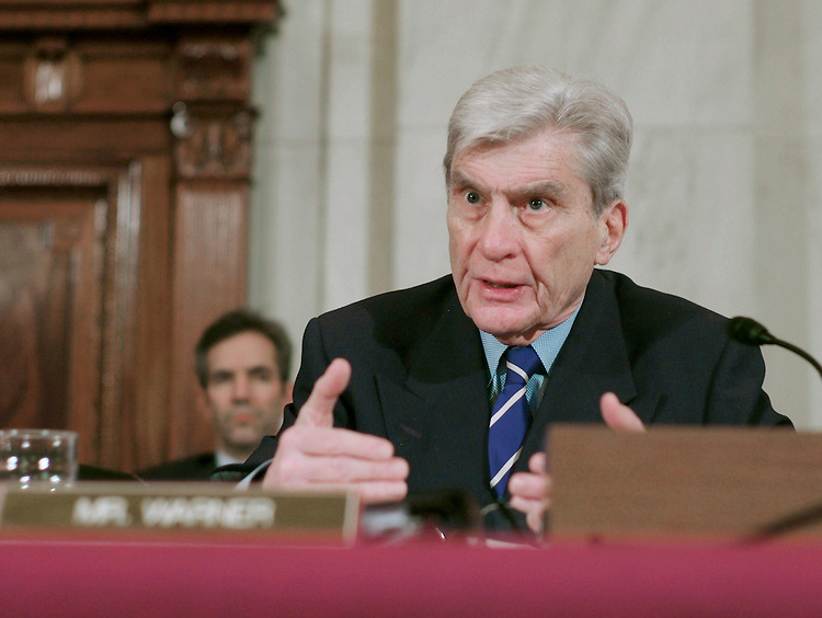 02/01/07--Sen. John W. Warner, R-Va., questions Gen. George W. Casey Jr. during Casey's Senate Armed Services confirmation hearing on his nomination to be reappointed to the grade of general and to be chief of staff of the Army. Casey, who served as commander of U.S. forces in Iraq since 2004,came under pointed criticism Thursday from senators of both parties. But he is still expected to win confirmation to be Army chief of staff. Key members of the Senate Armed Services Committee complained that Casey oversaw a flawed military strategy. In particular, they charged he had repeatedly painted overly optimistic scenarios of U.S. progress in Iraq. ÒWhile I donÕt in any way question your honor, your patriotism or your service to our country, I do question some of the decisions, the judgments youÕve made over the past two and a half years,Ó said Sen. John McCain of Arizona, the top Republican on the panel. ÒDuring that time things have gotten markedly and progressively worse.Ó McCain has repeatedly called for more U.S. troops in Iraq, something Casey resisted. However, Chairman Carl Levin, D-Mich., and other committee Democrats said Casey should not be made the scapegoat for a failed Iraq policy. Responsibility rests with the president and other top civilian leaders, they said. Congressional Quarterly Photo by Scott J. Ferrell