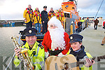 Getting ready for the Garda Carol singing in Tralee on the 22nd of December in aid of the Fenit lifeboat service on Tuesday, front from left Garda Dave Rath, Garda Seamus Moriarty and Garda Claire McDermott..Back JP Brick, Ollie Switzer, Inspector Martin McCarthy, Finbarr O'Connell and Kevin Hunt.