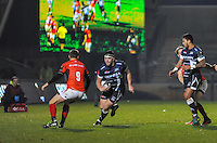 Sale Sharks Cameron Neild side steps Saracens's No 9 Richard Wigglesworth during the European Rugby Champions Cup match between Sale Sharks and Saracens at AJ Bell Stadium, Salford, England on 18 December 2016. Photo by Paul Bell.