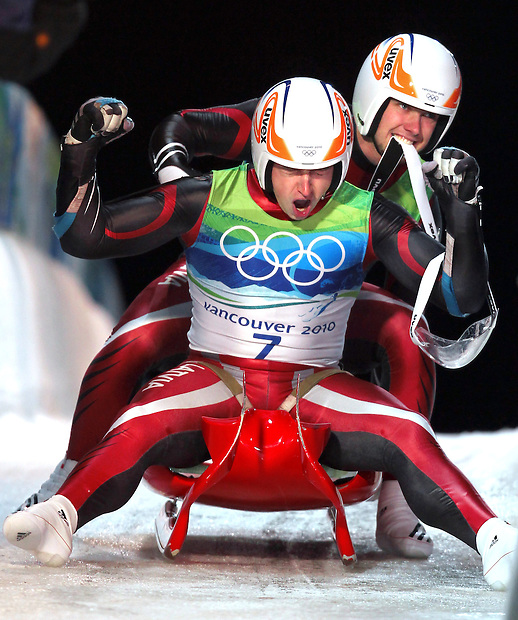 Latvia's Andris Sics, front, and Juris Sics celebrate winning the silver medal in the men's doubles luge at the XXI Olympic Winter Games Wednesday, February 17, 2010 at the Whistler Sliding Center in Whistler, British Columbia.