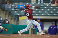 Matt Cuppari (23) of the Saint Joseph's Hawks follows through on his swing against the Western Carolina Catamounts at TicketReturn.com Field at Pelicans Ballpark on February 23, 2020 in Myrtle Beach, South Carolina. The Hawks defeated the Catamounts 9-2. (Brian Westerholt/Four Seam Images)