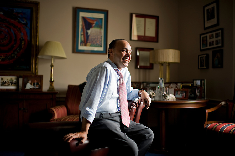 UNITED STATES - JUNE 22:  Rep. Luis Gutierrez, D-Ill., is photographed for a story about his former career as a cab driver in his Rayburn office.  (Photo By Tom Williams/Roll Call)