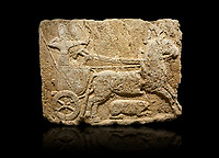 Hittite monumental relief sculpted orthostat stone panel. Limestone, Karkamıs, (Kargamıs), Carchemish (Karkemish), 900-700 B.C. Hunting carriage. Anatolian Civilisations Museum, Ankara, Turkey.<br /> <br /> Two human figures; one handling the carriage, the other throwing arrows. Both figures are wearing a headdress shaped like a skullcap. The dagger at the waist of the figure throwing arrow draws attention. There is an animal between the legs of the horse having an aigrette over its head.  <br /> <br /> Against a black background.