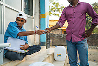 A customer uses his RFID debit card to buy safe water from the iJal station in Peddapur, a remote village in Warangal, Telangana, India, on 22nd March 2015. Safe Water Network works with local communities that live beyond the water pipeline to establish sustainable and reliable water treatment stations within their villages to provide potable and safe water to the communities at a nominal cost. Photo by Suzanne Lee/Panos Pictures for Safe Water Network