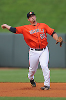 Greenville Astros third baseman Tyler White #56 throws to first first during a game against the Kingsport Mets at Pioneer Park on August 4, 2013 in Greenville, Tennessee. The Astros won the game 17-1. (Tony Farlow/Four Seam Images)