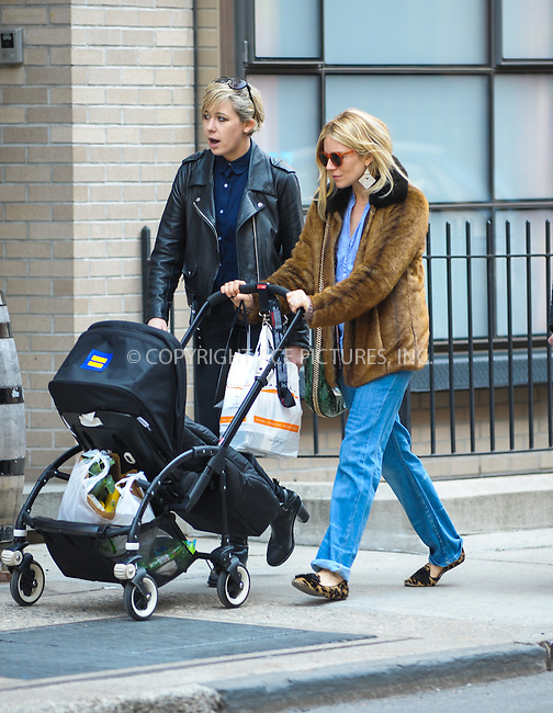 WWW.ACEPIXS.COM....April 2013, New York City....Actress Sienna Miller enjoys the Spring weather around her West Village neigborhood during April 2013  in New York City......By Line: JB Nichols/ACE Pictures......ACE Pictures, Inc...tel: 646 769 0430..Email: info@acepixs.com..www.acepixs.com
