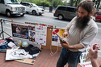 YAHWEH's Flat Earthers proselytize on Massachusetts Avenue on the campus of MIT during a solar eclipse viewing event in Cambridge, Massachusetts, USA, on Mon., Aug. 21, 2017. This solar eclipse is the first in nearly 40 years to have a path observable total eclipse from coast to coast in the United States. People at this location in Massachusetts, however, only observed about 66% coverage of the moon over the sun. These Flat Earth believers claim that NASA is lying to the public about the shape of the Earth.