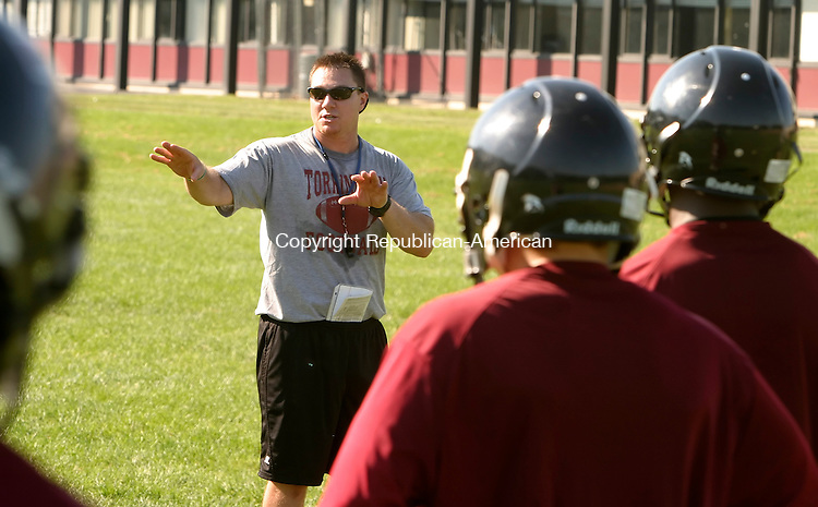 TORRINGTON, CT --AUGUST 18, 2008-081808JS03-Torrington HIgh School football coach Dan Dunaj, center, instructs his players during ther first day of practice Monday at Torrington High School. <br /> Jim Shannon/Republican-American