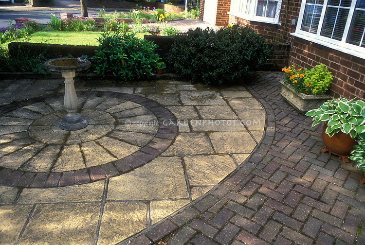 19170 Patterned patio in brick and stone pavers, with birdbath