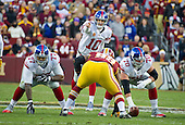 New York Giants quarterback Eli Manning (10) directs the offense in the first quarter of the game against the Washington Redskins at FedEx Field in Landover, Maryland on Sunday, January 1, 2017.  Blocking for Manning are guard John Jerry (77) and center Weston Richburg (70).  Washington Redskins defensive end Chris Baker (92) is ready to pressure Manning.  The Giants won the game 19 - 10.<br /> Credit: Ron Sachs / CNP<br /> (RESTRICTION: NO New York or New Jersey Newspapers or newspapers within a 75 mile radius of New York City)