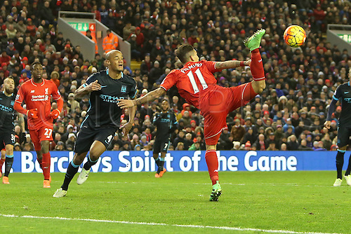 02.03.2016. Anfield Stadium, Liverpool, England. Barclays Premier League. Liverpool versus Manchester City<br /> Roberto Firmino of Liverpool makes an acrobatic leap to try to reach a high cross as Vincent Company of Manchester City looks on