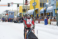 Mushers head out from the start line in downtown Anchorage on day two of the World Championship Sled Dog Races, a highlight of the 2013 Anchorage, Alaska, Fur Rendezvous.